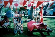 Speak Out!... Canada... Pensons-y! Member and child at Coronation Park during the Oakville Waterfront Festival