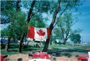 Canada Flag hanging between two trees at Coronation Park during the Oakville Waterfront Festival in 1998